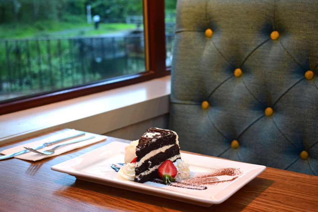 chocolate cake and seating at Glen Lusset Bar Old Kilpatrick